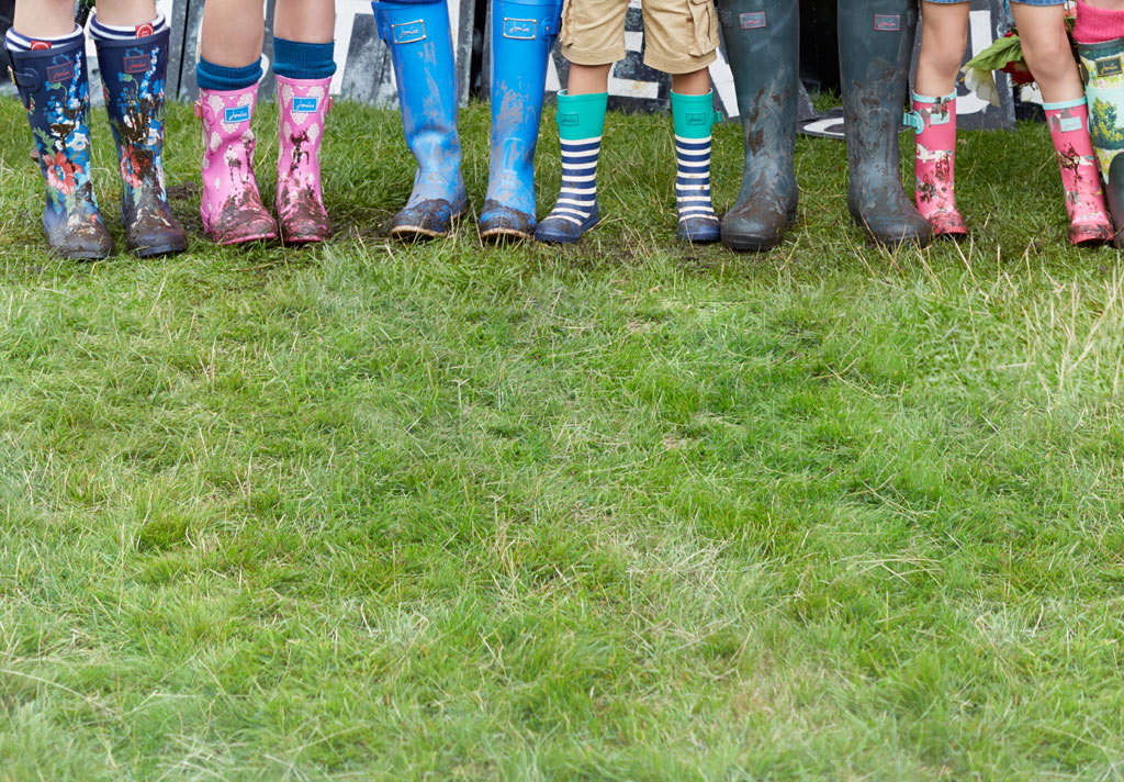 People with wellies covered in mud